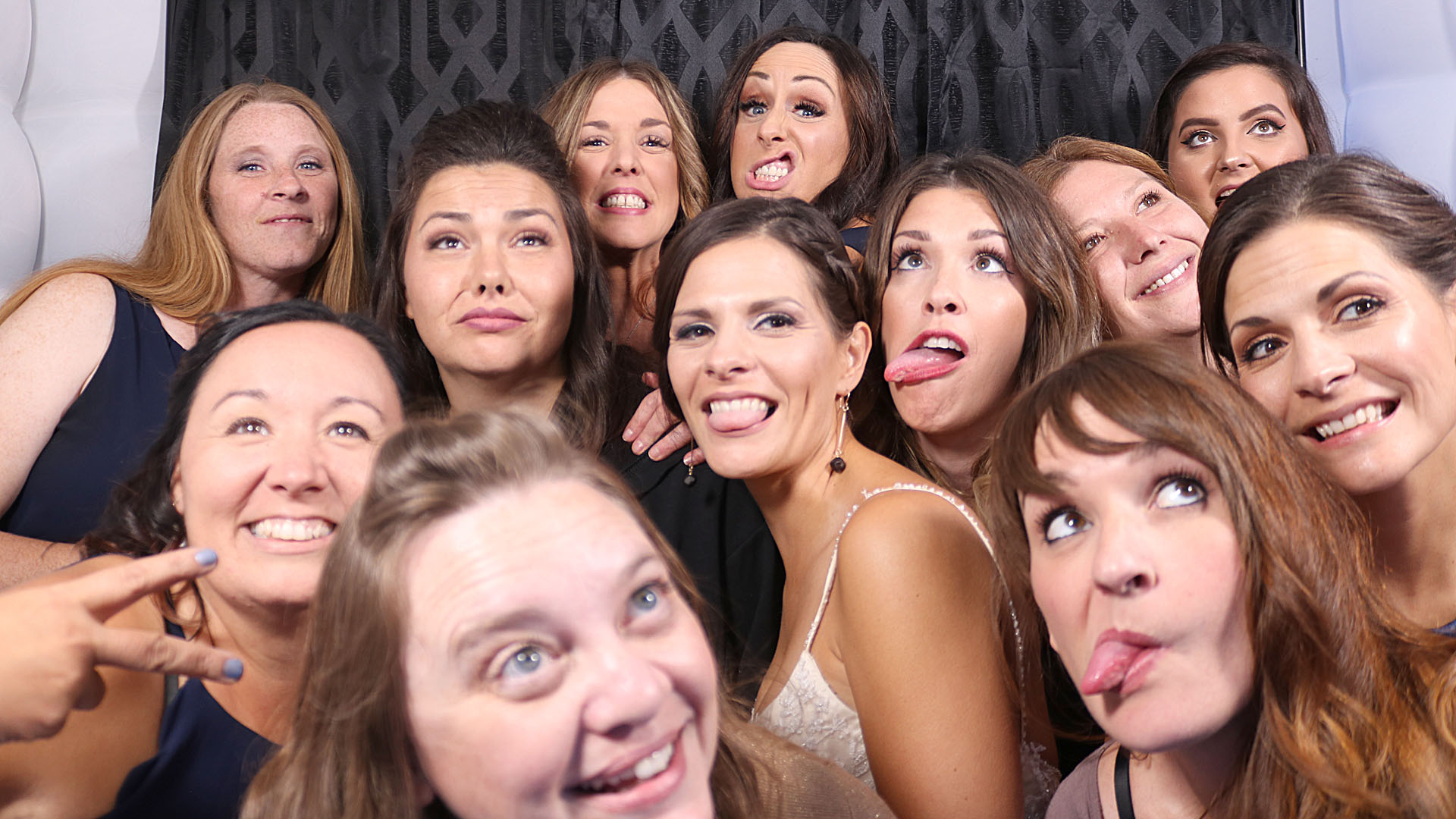 "Wedding Party crams into ""The Cube"" to get a photo in the Photo Booth"